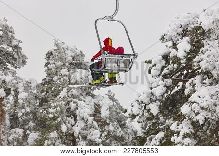 Ski Lift And Slope On A Snow Landscape. Winter Sport