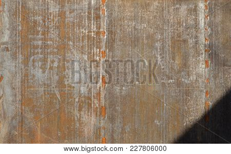 Old Rusty Metal Background Or Texture With Sun Shadow
