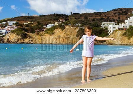 Girl Relaxing On Cretan Sea. Resort Bali, Greece