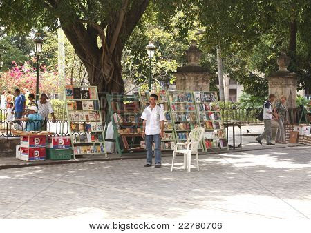 Bookseller At The Secondhand Bookmarket In Havana