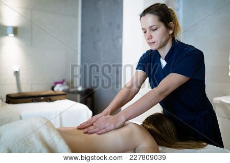 Stress Relieving Massage Treatment By Masseur In Wellness Spa