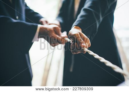 Business Cooperation Concept. Image Of Business Team Pulling A Rope As An Element Of The Success Tea