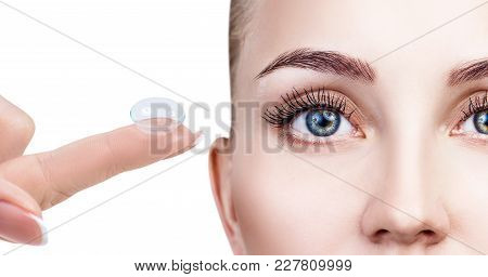 Contact Lens On Index Finger Near Beautiful Female Face. Eyesight And Ophthalmology Concept.