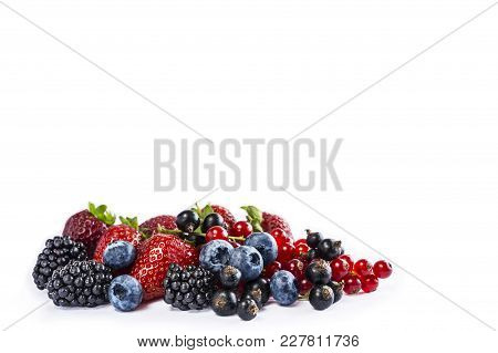 Mix Berries And Fruits Isolated On A White. Ripe Blueberries, Blackberries, Currants And Strawberrie