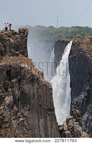 Livingstone, Zambia-november 23, 2017: Tourists At The Victoria Falls, Zimbabwe, Zambia, Africa