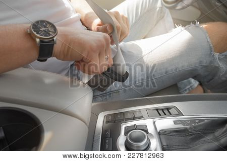 Man Putting Car Seat Belt Before Driving, Close Up At Belt Buckle, Safe Drive Concept, Selective Foc