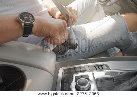 Man Putting Car Seat Belt Before Driving, Close Up At Belt Buckle, Safe Drive Concept, Selective Foc