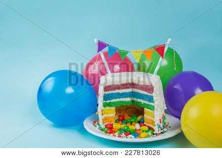 Rainbow Pinata Cake With Candies - Birthday Background, Card, Concept - Copy Space