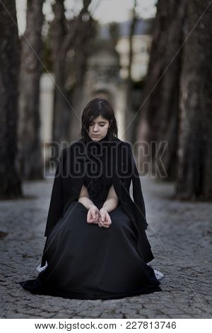 Mourning Woman In A Grave Yard In Black
