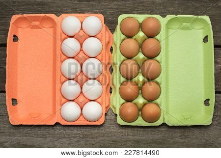 Carton Of Organic White And Asian Eggs On Wooden Background. Top View.