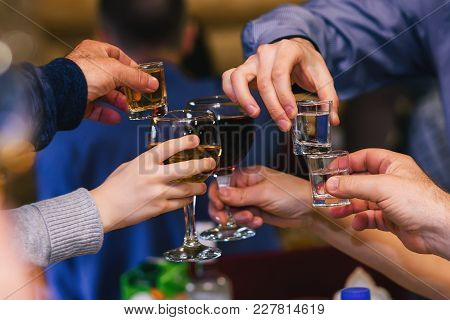 Hands With Glasses Of Wine And Vodka At The Festive Event