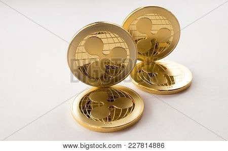 On The White Background Are Gold Coins Of A Digital Virtual Crypto  Currency - Ripple - Xrp. In Addi