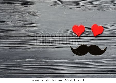 Paper Mustache And Red Hearts On Grey Wooden Background
