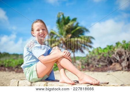 Adorable Active Little Girl At Beach During Summer Vacation