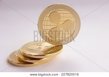 On The White Background Are Gold Coins Of A Digital Crypto  Currency - Ripple Xrp. On The Inclined P