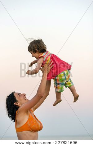 Mother Throwing Her Daughter In Air