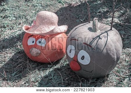 Two Large Pumpkins In The Form Of Funny Men.