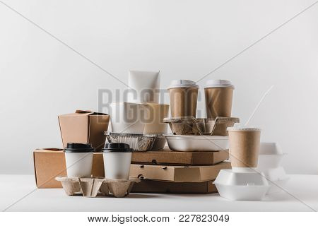 pizza boxes and disposable coffee cups with take away boxes on tabletop poster