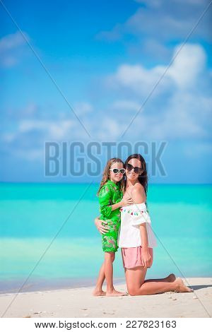 Family Fun On White Sand. Smiling Mother And Child Playing At Sandy Beach On A Sunny Day