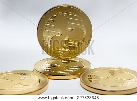 On A Black And White Background Are Gold Coins Of A Digital Crypto  Currency - Ripple Xrp. In Additi