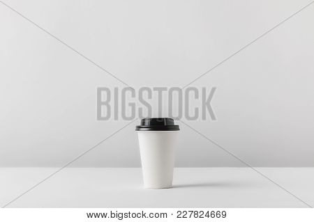 View Of Disposable Coffee Cup On White Tabletop