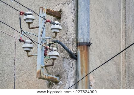 Closeup Of Old Wires And Risky Power Supply With Obsolete Equipment