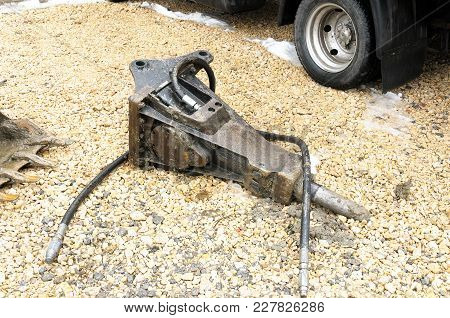 Big Hydraulic Hammer Breaker For Excavator Machinery Standing On The Ground Prepared To Crack Asphal