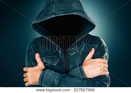 Mysterious Suspicious Faceless Man With Hoodie, Dark Low Key Portrait For Crime And Violence Concept