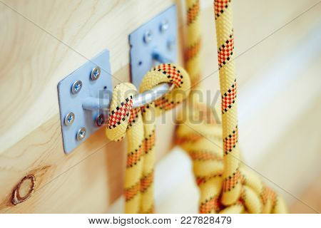Metal Screw Nails Are Embed On White Wall And Tied With White Rope, Concept Is Connection.
