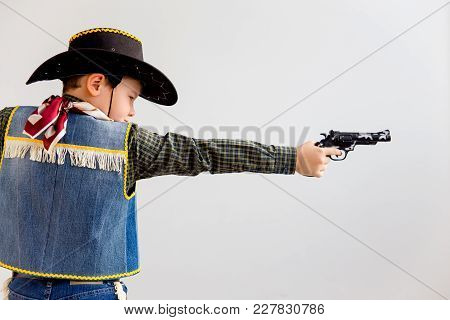 A Boy Dressed Up As A Cowboy