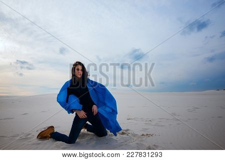 Expressive Girl, Wearing In A Flying Blue Scarf, Posing In The Desert On The Wind - On The Beginning