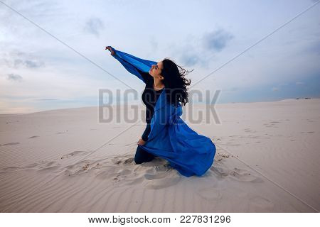 Expressive Girl, Wearing In A Flying Blue Scarf, Is Playing With Wind In The Desert - On The Beginni