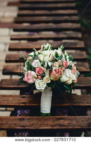 Wedding Bouquet For Bride From Roses And Other Great Flowers On The Background Of A Wooden Textured
