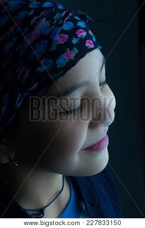 Beautiful Girl Smiling In Front Of Artificial Light