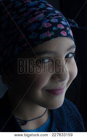 Smiling Child Girl Portrait Under Artificial Light