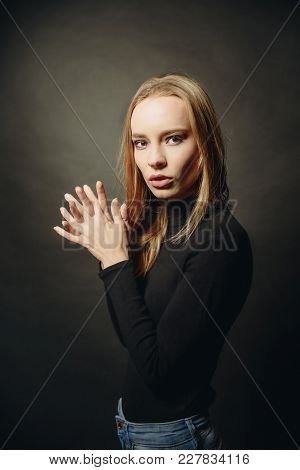Wow. Close Up Portrait Of Cheerful Coquette Lady In Black Pullover Over Dark Studio Background.