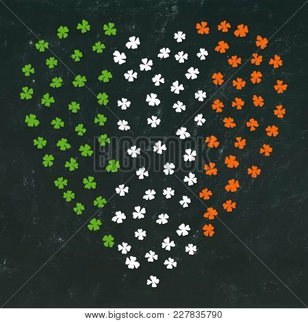 Clovers Heart For St. Patrick's Day. Irish Flag. Ireland Flag Made Of Clover Laef. Chalkboard Backgr