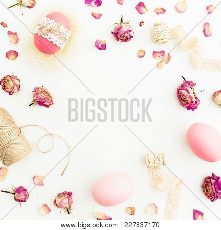 Frame Of Easter Pink Eggs With Twine, Roses Flowers And Tapes On White Background, Top View, Fat Lay