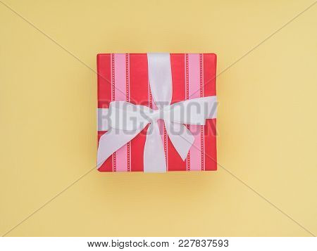 Wrapped Gift Box.  Pastel Colour Flat Lay Minimal Concept.