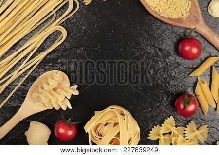 An Overhead Photo Of Different Types Of Pasta, Including Spaghetti, Orzo, Fusilli, Penne, With Cherr