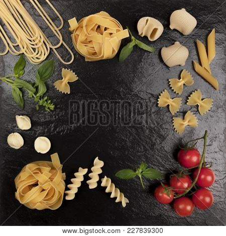 An Overhead Photo Of Different Types Of Pasta, Including Spaghetti, Penne, Fusilli, And Others, Shot