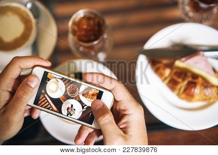 Hands With Phone. Breakfast For Two: A Croissant With Ham, Coffee, A Refreshing Drink, Sweetness.