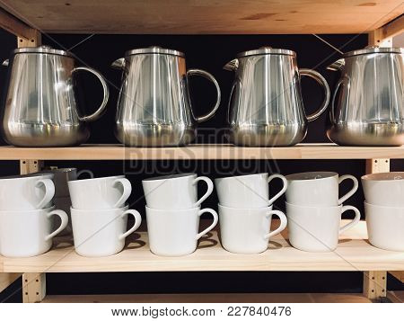 Opened Wooden Cupboard With Kitchenware Inside, Kitchen Decoration Interior, Coffee Cup And Stainles