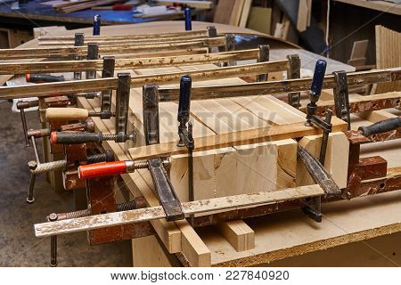 Metal Clamps Pulling Wooden Blocks In The Workshop