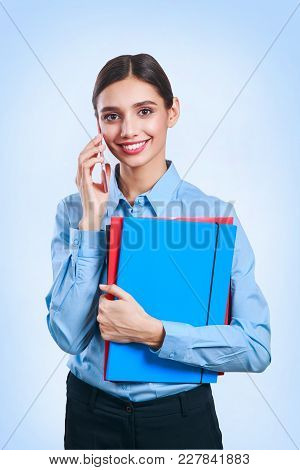 Successful Businesswoman Or Entrepreneur Taking Notes And Talking On Cellphone