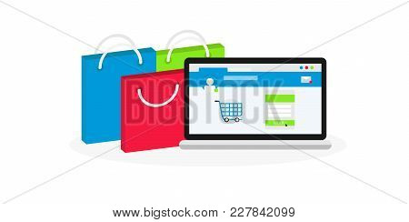 Computer Near Shopping Bags. Online Market On Laptop Screen. Concept Of E-commerce And Online Shoppi