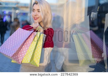 Shopper Woman Walking And Shopping In The Street In Summer Holding Bags
