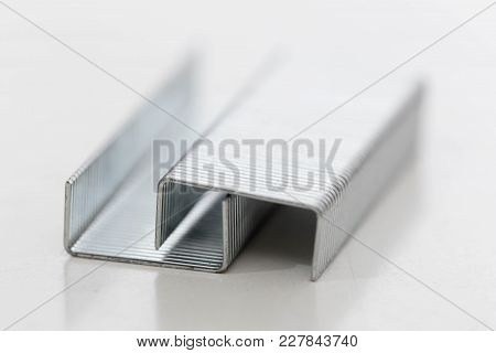Isolated Stapler Clips Against A White Background In A Studio