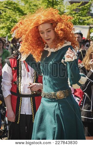 April, 19, 2014, Haarzuilens, The Netherlands: Beautiful Young Woman With Red Wig Is Dancing During