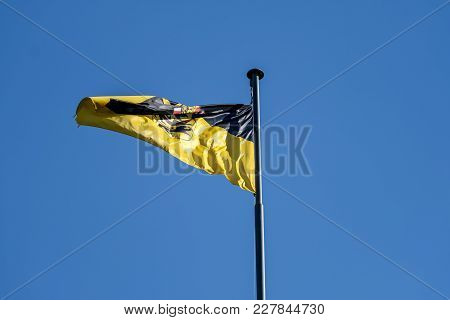 Waving Baden Wuerttemberg Flag On A Sunny Day In Stuttgart, Germany